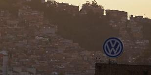 A Volkswagen logo is pictured in front of a slum, at the Volkswagen plant in Sao Bernardo do Campo, near Sao Paulo January 8, 2015.  REUTERS/Nacho Doce
