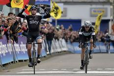 Sky team rider Ian Stannard of Britain crosses the finish line to win the Omloop Het Nieuwsblad cycling race ahead of Quick Step team rider Niki Terpstra of the Netherlands in Ghent February 28, 2015.    REUTERS/Eric Vidal