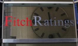 Часы в офисе Fitch Ratings в Нью-Йорке. 6 февраля 2013 года. Международное рейтинговое агентство Fitch Ratings не видит проблем с рефинансированием долговых обязательств российскими компаниями в 2015 и 2016 годах, говорится в докладе агентства, посвященном способности российских корпораций погасить свои долговые обязательства в этот период. REUTERS/Brendan McDermid