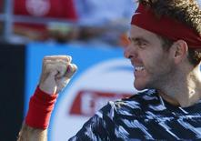 Juan Martin Del Potro of Argentina celebrates his win over top seed Fabio Fognini of Italy in their men's singles second round match at the Sydney International tennis tournament in Sydney, January 14, 2015.    REUTERS/Jason Reed