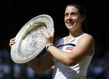 Marion Bartoli of France holds her winners trophy, the Venus Rosewater Dish, after defeating Sabine Lisicki of Germany in their women's singles final tennis match at the Wimbledon Tennis Championships, in London July 6, 2013.      REUTERS/Stefan Wermuth