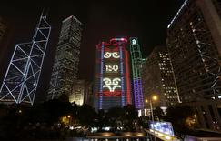 "A lighting show displays ""150 anniversary"" on HSBC headquarters in Hong Kong, March 3, 2015.  REUTERS/Bobby Yip"