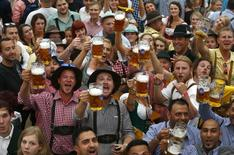 Visitors toast with their one-liter beer mugs during the opening day of the 181st Oktoberfest in Munich September 20, 2014.        REUTERS/Michael Dalder