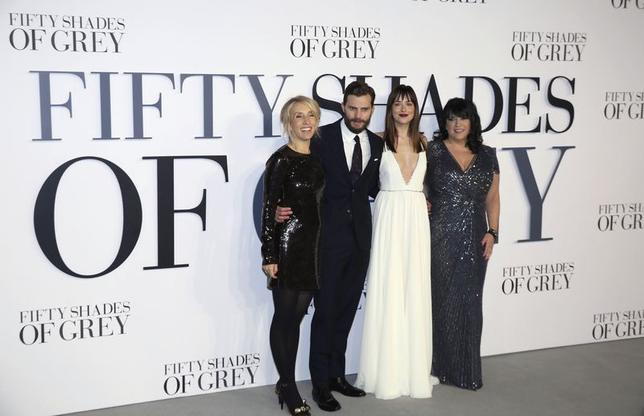 (L-R) Director of the film Sam Taylor-Johnson, cast members Jamie Dornan, Dakota Johnson and author E. L. James arrive for the British premiere of the movie 'Fifty Shades of Grey' in London February 12, 2015. REUTERS/Paul Hackett