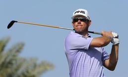 Lee Westwood of England tees off on the tenth hole during the final round of the Dubai Desert Classic February 1, 2015. REUTERS/Fadi Al-Assaad