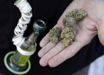 An attendee holds out several marijuana buds at the High Times U.S. Cannabis Cup in Seattle, Washington, in this file photo taken September 8, 2013.    REUTERS/Jason Redmond/Files