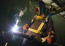 A welder works fabricating a piece of equipment at Sequoia Environmental Remediation, a leading environmental supply and service company in Calgary, Alberta, June 3, 2014.  REUTERS/Todd Korol