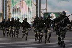 Members of the Saudi security forces take part in a military parade in preparation for the annual Haj pilgrimage in the holy city of Mecca September 28, 2014. REUTERS/Muhammad Hamed