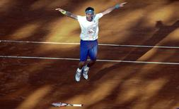 Argentina's Leonardo Mayer celebrates after defeating Brazil's Joao Souza in their Davis Cup tennis match in Buenos Aires, March 8, 2015.    REUTERS/Marcos Brindicci
