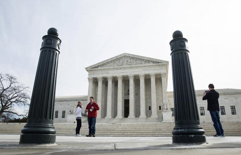 Tourists walk in front of the Supreme Court in Washington March 9, 2015.  REUTERS/Joshua Roberts