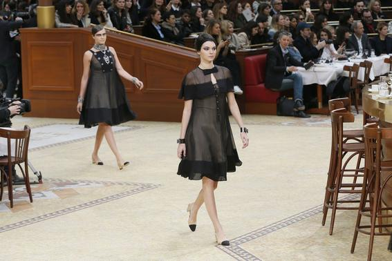 Models Kendall Jenner (R) and  Cara Delevingne (L) present creations by German designer Karl Lagerfeld as part of his Autumn-Winter 2015-2016 women's ready-to-wear collection for French fashion house Chanel during Paris Fashion Week March 10, 2015.    REUTERS-Gonzalo Fuentes