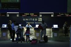 People are seen in the United Airlines terminal at Newark International Airport in New Jersey, July 22, 2014. REUTERS/Eduardo Munoz