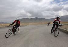 Masooma Alizada (L), and Zahra Alizada (R), member of Afghanistan's Women's National Cycling Team exercise on the outskirts of Kabul February 20, 2015. REUTERS/Mohammad Ismail
