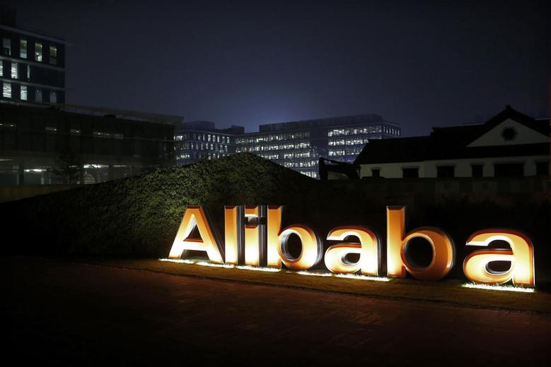 The logo of Alibaba Group is seen inside the company's headquarters in Hangzhou, Zhejiang province early November 11, 2014. Alibaba Group Holding Ltd said about $2 billion worth of goods were sold on the e-commerce giant's websites within the first hour and 12 seconds of its annual shopping festival. REUTERS/Aly Song (CHINA - Tags: BUSINESS LOGO) - RTR4DNED