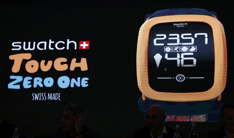 The new 'Swatch Touch Zero One' is seen on a screen during the Swiss watchmaker's annual news conference in Corgemont March 12, 2015.  REUTERS/Denis Balibouse