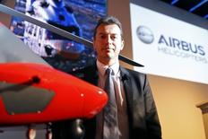 Airbus Helicopters Chief Executive Guillaume Faury poses next to a model of the EC175 after a news conference in Paris, January 28, 2014. REUTERS/Charles Platiau