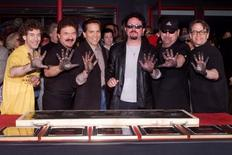 Members of the rock band Toto pose after placing their handprints in cement as they were inducted into Hollywood's RockWalk May 4 in Hollywood.  FSP/JP - RTROTKU
