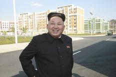 North Korean leader Kim Jong Un gives field guidance to the newly built Wisong Scientists Residential District in this undated photo released by North Korea's Korean Central News Agency (KCNA) in Pyongyang October 14, 2014.  REUTERS/KCNA