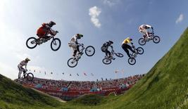 Cyclists compete in the men's BMX final during the London 2012 Olympic Games at the BMX Track in the Olympic Park August 10, 2012.  REUTERS/Paul Hanna