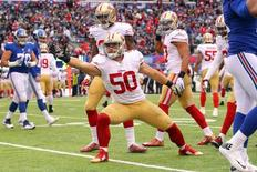San Francisco 49ers linebacker Chris Borland (50) signals a first down after an interception against the New York Giants during the second quarter at MetLife Stadium. Mandatory Credit: Brad Penner-USA TODAY Sports
