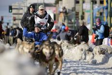 2014 Iditarod Champion Dallas Seavey (2nd L standing) and IditaRider Gerald Ingram (seated) participate at the 2015 ceremonial start of the Iditarod Trail Sled Dog race in downtown Anchorage, Alaska March 7, 2015. REUTERS/Mark Meyer