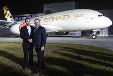 Fabrice Bregier, CEO of Airbus, (L) and James Hogan, CEO of Etihad Airways, shakes hands in front of an Airbus A380 during the branding ceremony of Etihad Airways, the national airline of the United Arab Emirates (UAE), at the German headquarter of aircraft company Airbus, in Hamburg-Finkenwerder September 25, 2014.  REUTERS/Fabian Bimmer