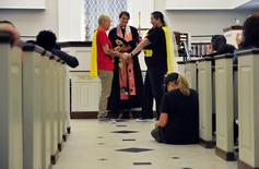 Rachel Baker (L) and Kathy Voigtschild get married by Reverend Lori Walke at a multi-marriage ceremony at Mayflower Congregational Church in Oklahoma City, Oklahoma in this October 6, 2014 file photo. REUTERS/Nick Oxford