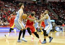 Mar 19, 2015; Houston, TX, USA; Houston Rockets guard James Harden (13) drives against Denver Nuggets forward Danilo Gallinari (8) in the second half at Toyota Center. Rockets won 118 to 108. Mandatory Credit: Thomas B. Shea-USA TODAY Sports