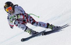 Anna Fenninger of Austria skis during the women's downhill race at the Alpine Skiing World Cup Finals in Meribel, in the French Alps, March 18, 2015.  REUTERS/Christian Hartmann