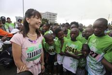 Japan's Olympic gold medal-winning marathon runner Naoko Takahashi looks on with young competitors as she waits to compete in the Sotokoto half-marathon in Kenya's capital Nairobi May 23, 2010. REUTERS/Noor Khamis