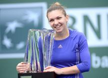 Mar 22, 2015; Indian Wells, CA, USA; Simona Halep (ROM) holds the championship trophy after she defeated Jelena Jankovic (SRB) in the finals of the BNP Paribas Open at the Indian Wells Tennis Garden. Jayne Kamin-Oncea-USA TODAY Sports