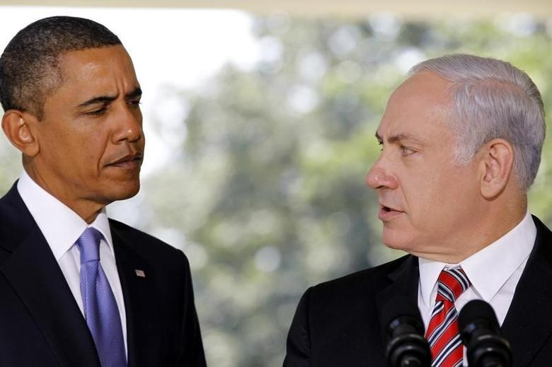 U.S. President Barack Obama (L) listens as Israeli Prime Minister Benjamin Netanyahu delivers a statement to the media from the Colonnade outside the Oval Office of the White House in Washington September 1, 2010. REUTERS/Jason Reed