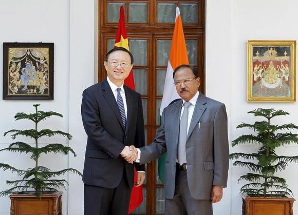 China's State Councilor Yang Jiechi (L) and India's National Security Advisor Ajit Doval shake hands during a photo opportunity before their meeting in New Delhi March 23, 2015. REUTERS/Stringer
