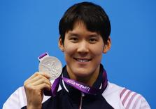 South Korea's Park Tae-hwan poses with his silver medal for the men's 200m freestyle final at the London 2012 Olympic Games at the Aquatics Centre July 30, 2012. REUTERS/David Gray