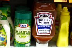 A Heinz Ketchup bottle and a bottle of Kraft parmesan cheese are displayed in a grocery store in New York March 25, 2015. REUTERS/Eduardo Munoz