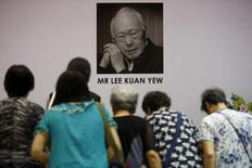 People bow as they pay their respects at Tanjong Pagar community club, in the constituency which Lee represented as Member of Parliament since 1955. REUTERS/Edgar Su