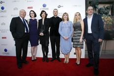 "Creator Julian Fellowes (L) and executive producer Gareth Neame (R) pose with cast members Michelle Dockery, Elizabeth McGovern, Rob James-Collier, Phyllis Logan and Joanne Froggatt (2nd L-2nd R) at ""An Evening with Downton Abbey"" at the Leonard H. Goldenson Theatre in North Hollywood, California June 10, 2013. REUTERS/Danny Moloshok"