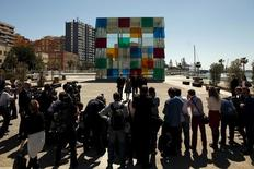 (L-R) Malaga's Mayor Francisco de la Torre, French Culture Minister Fleur Pellerin, Spain's Prime Minister Mariano Rajoy and Centre Pompidou President Alain Seban pose for photographers in front of the Cube, outside the new Malaga branch of the Centre Pompidou after its inauguration in Malaga, southern Spain March 28, 2015. REUTERS/Jon Nazca