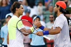 Mar 29, 2015; Key Biscayne, FL, USA; Fernando Verdasco (R) shakes hands with Rafael Nadal (L) after their match on day seven of the Miami Open at Crandon Park Tennis Center. Geoff Burke-USA TODAY Sports