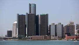 The city of Detroit skyline, including General Motors Global Headquarters, is seen along the Detroit River from Windsor, Canada June 15, 2012.  REUTERS/Rebecca Cook