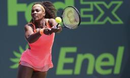 Serena Williams hits a backhand against Svetlana Kuznetsova (not pictured) on day eight of the Miami Open at Crandon Park Tennis Center. Williams won 6-2, 6-3. Mandatory Credit: Geoff Burke-USA TODAY Sports