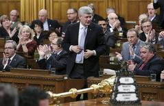 Canada's Prime Minister Stephen Harper stands to vote in the House of Commons on Parliament Hill in Ottawa March 30, 2015. REUTERS/Chris Wattie