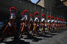 New recruits of the Vatican's elite Swiss Guard march during the swearing-in ceremony at the Vatican  May 6, 2014.  REUTERS/Tony Gentile