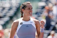 Andrea Petkovic celebrates after her match against Karolina Pliskova (not pictured) on day nine of the Miami Open at Crandon Park Tennis Center. Petkovic won 6-4, 6-2. Mandatory Credit: Geoff Burke-USA TODAY Sports