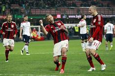 AC Milan's Jeremy Menez (C) celebrates after scoring against Cagliari during their Italian Serie A soccer match at the San Siro stadium in Milan March 21, 2015. REUTERS/Alessandro Garofalo