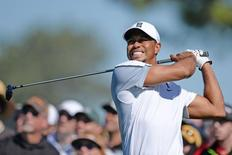 Feb 5, 2015; La Jolla, CA, USA; Tiger Woods hits his drive on the 12th during the first round of the Farmers Insurance Open golf tournament at Torrey Pines Municipal Golf Course - South Co. Mandatory Credit: Jake Roth-USA TODAY Sports