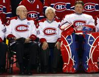 Montreal Canadiens legends (L-R) Emile Bouchard, Elmer Lach and Patrick Roy sit together during a ceremony to celebrate the Canadiens 100th anniversary in Montreal, in this December 4, 2009. REUTERS/Shaun Best/Files