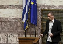 Greek Finance Minister Yanis Varoufakis walks next to a European Union and a Greek national flag during a parliamentary session in Athens April 2, 2015.   REUTERS/Alkis Konstantinidis