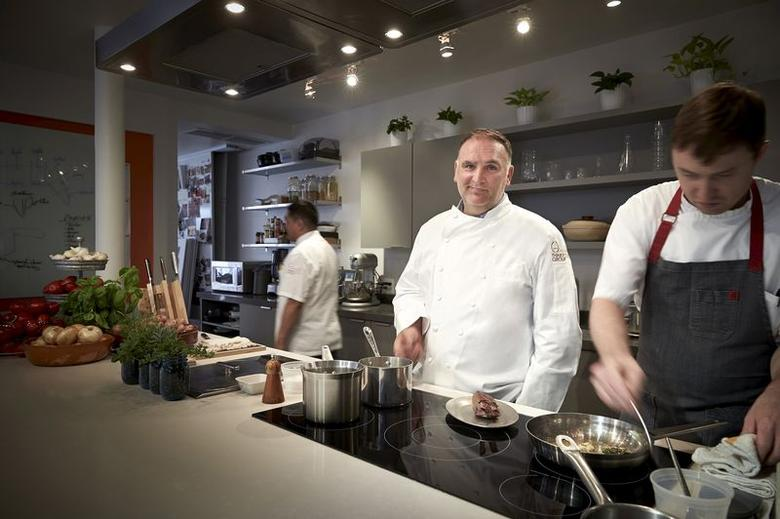 Chef Jose Andres is seen in the Think Food Group Offices test kitchen in Washington DC in this handout picture courtesy of Greg Powers taken in 2014.  REUTERS/Greg Powers/Handout via Reuters