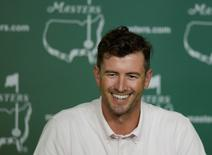 Apr 7, 2015; Augusta, GA, USA;  2013 Masters champion Adam Scott speaks with the media during a press conference on a practice round day for The Masters golf tournament at Augusta National Golf Club. Mandatory Credit: Michael Madrid-USA TODAY Sports